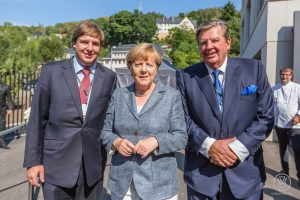 od lewej: Anton Rupert, Angela Merkel, Johann Rupert