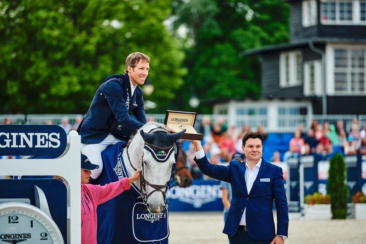 Zwycięzca Grand Prix, Szwed Henrik von Eckermann i Leszek Pilch Brand Manager Longines